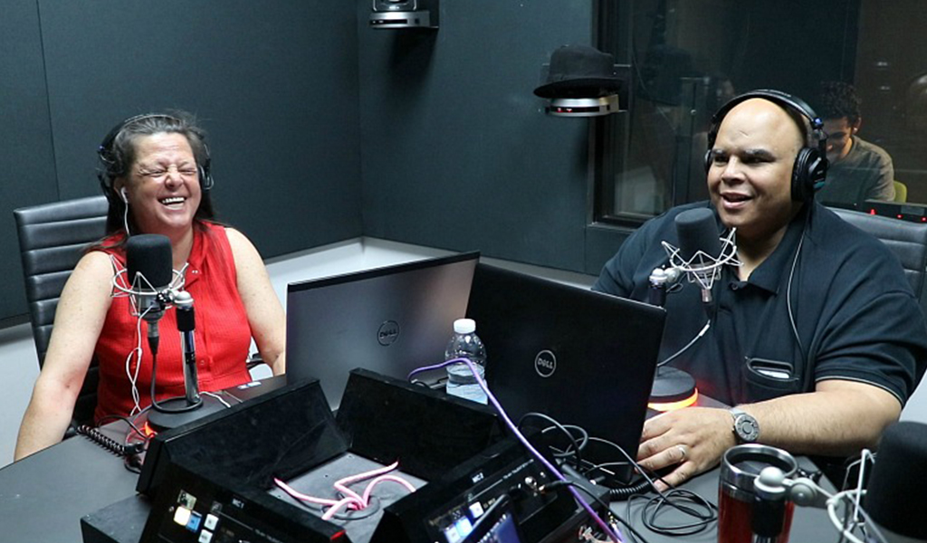 Milena laughs in studio with Kelly.