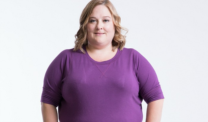 Participant Mary Beth stands facing the camera wearing a purple shirt.